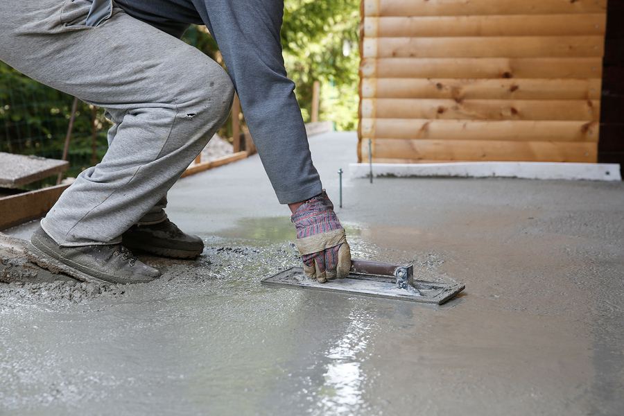 man leveling and screeding concrete