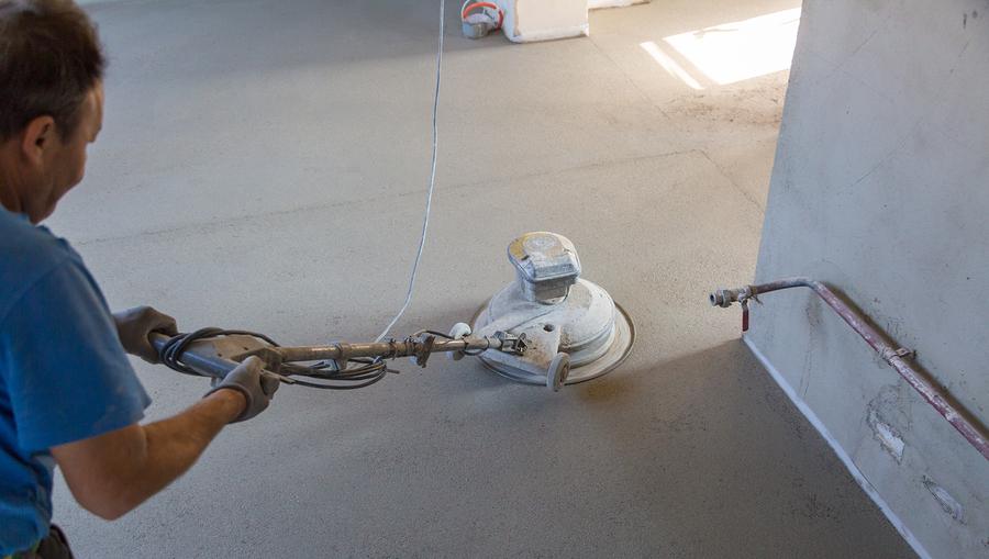Laborer performing and polishing sand