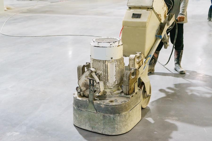 Women worker using polishing machine